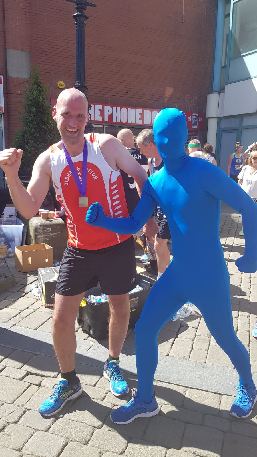 Blue Running Man with Oldham & Royton Harrier