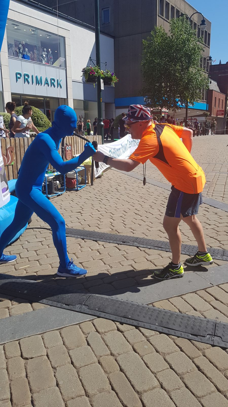 blue running man at oldham 10k milltown to moors race series