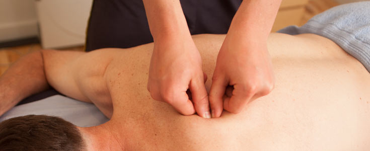 Sports Massage for tension near shoulder blades.